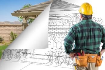 a Ballarat Carports worker looking at a blueprint